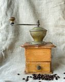 Ancient coffee grinder Stock Images