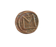 Ancient Coin. Ancient copper coin isolated on white background with clipping path Royalty Free Stock Photography