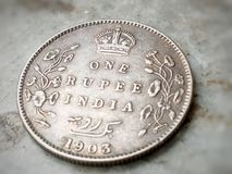 The ancient coin of india. The ancient one rupee silver coin of india Royalty Free Stock Photos