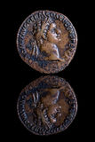 Ancient Coin Reflection - Domitian Royalty Free Stock Photos