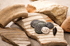 Ancient coins. And broken earthenware Stock Photography