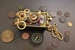 Ancient coins, casket, beads and compass. stock images