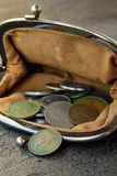 Ancient coins in the open vintage purse stock images