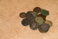 Ancient   coins with portraits of kings on the old cloth Royalty Free Stock Images