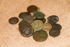 Ancient   coins with portraits of kings on the old cloth Royalty Free Stock Photography