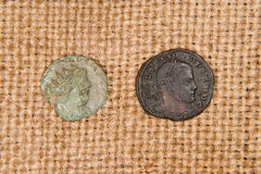 Ancient   coins with portraits of kings on the old cloth Stock Photos