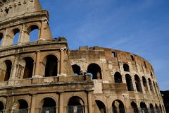 Ancient coliseum ruins in rome on deep blue sky background royalty free stock images