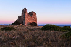 Ancient collapsed tower. A ruined tower near the coastline in Salento (south of Italy Stock Photos