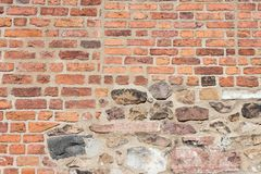Ancient Colorful Brick Wall. With Parts of the Wall Severly Worn Out Stock Photos