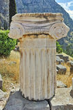 Ancient column in Ancient Greek archaeological site of Delphi, Greece Stock Image
