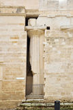 Ancient column in the medieval wall Stock Photo