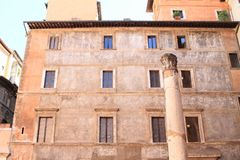 Ancient column in Rome. Ancient stone column in front of old house in Rome, Italy stock photos