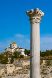 Ancient column and temple on the blue sky Royalty Free Stock Photo
