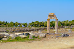 Ancient columns and arch. Stock Image