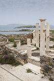 Ancient columns in the archeologic site of Delos Stock Images