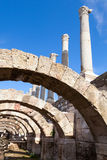 Ancient columns and arches. Smyrna, Turkey. Ancient columns and arches on blue sky background, fragment of ruined roman temple in Smyrna. Izmir, Turkey Royalty Free Stock Photography