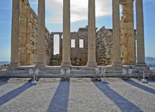 Ancient columns in Athens Greece. Ancient columns with shadows in Athens, Greece Royalty Free Stock Images