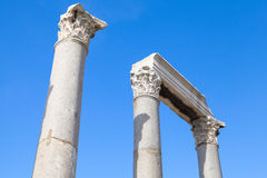 Ancient columns and portico fragment on blue sky Royalty Free Stock Photos