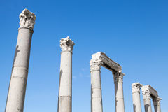 Ancient columns in a row on blue sky background Royalty Free Stock Photography