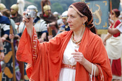 Ancient communication. Romaia - Rome celebrates its foundation, April 2009: woman in ancient roman  costume Royalty Free Stock Images