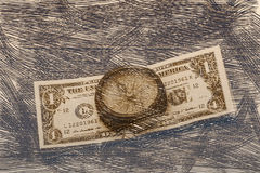 Ancient compass on the background of banknotes tapered. Ancient compass and banknotes in an abstract form stock illustration