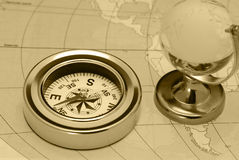 Ancient compass and glass globe Royalty Free Stock Photography
