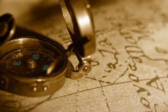 Ancient compass and map background Stock Photo