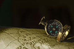 Ancient compass and map background Royalty Free Stock Photography