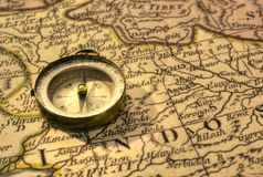 Ancient Compass and Map of India. Old compass and map of northern India close to border with Pakistan royalty free stock photo