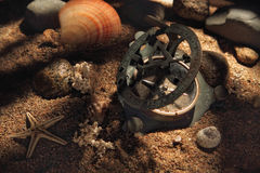 Ancient compass on the ocean floor Royalty Free Stock Photography