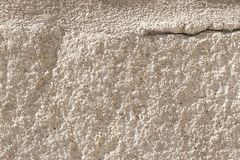 Ancient concrete wall with cement brown coating. A large crack in the upper left corner. Destruction of a worn building structure stock photos