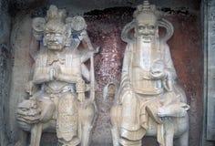 Ancient Confucian & Buddhist sculptures Stock Photos