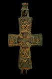 Ancient copper cross isolated on black Stock Image
