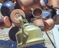 Ancient copper kettles and pans. Close up Royalty Free Stock Photography