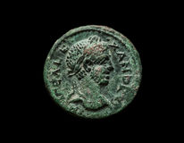 Ancient copper roman coin of emperor Alexander. Isolated on black, close-up shot Royalty Free Stock Photo