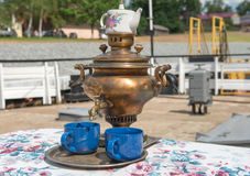 Ancient copper samovar on the pier to meet guests Royalty Free Stock Images