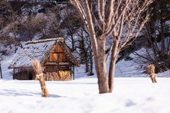 Ancient cottage in snow season Royalty Free Stock Image