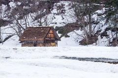 Ancient cottage in snow season Royalty Free Stock Images