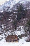 Ancient cottage in snow season Stock Photos