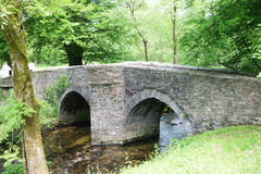 Ancient country bridge. Treverbyn Bridge, built in circa 1412 has carried traffic over the river Fowey in Cornwall UK, for the past 6oo years, Imagine if it Royalty Free Stock Images