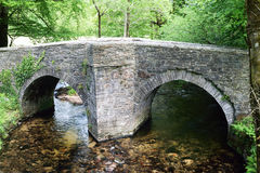 Ancient country bridge. Treverbyn Bridge, built in circa 1412 has carried traffic over the river Fowey in Cornwall UK, for the past 6oo years, Imagine if it Royalty Free Stock Image