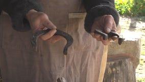 Ancient craft blacksmith stock footage