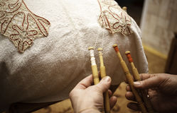 Ancient craft. The Needlewoman is Weaving graceful Lace Royalty Free Stock Images