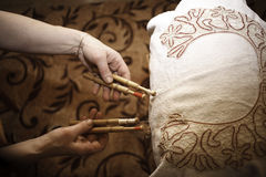 Ancient craft. The Needlewoman is Weaving graceful Lace Royalty Free Stock Photography