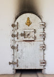 Ancient crematory door in temple Stock Photos