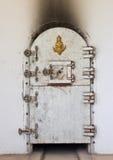 Ancient crematory door in temple Stock Photos