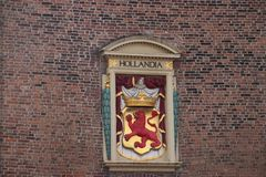 Ancient crest of the state of Hollandia, latin for Holland on the old prison and torture place named Gevangenpoort in The Hague, t. He Netherlands royalty free stock images