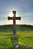 Ancient cross. An ancient cross at sunset Royalty Free Stock Image