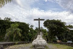 Ancient cross in Brazilian historical city. Cross at the foot of Morro de Itaguacu, which leads to the convent of Nossa Senhora da Conceição, built in the stock images