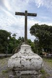 Ancient cross in Brazilian historical city. Cross at the foot of Morro de Itaguacu, which leads to the convent of Nossa Senhora da Conceição, built in the stock image
